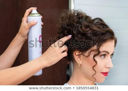 Fodrász jelentkezik hajlakk hosszú göndör haj nő Stock fotó © deandrobot