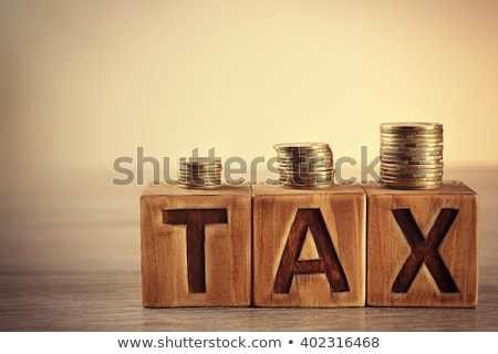 taxes sign on wooden table stock photo © fuzzbones0