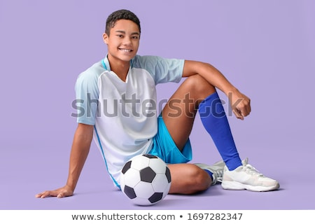A soccer player with a violet uniform Stock photo © bluering