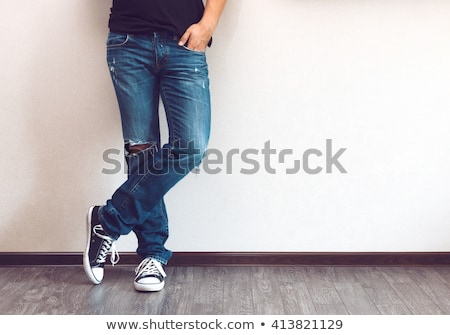 Legs in sneakers on wood background. Stock photo © dawesign