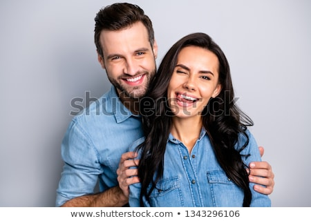 Cheerful joyful young man winking and having fun Stock photo © deandrobot