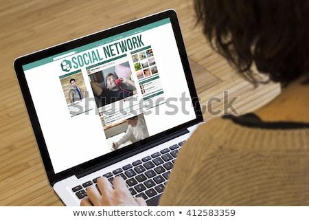 Közösség laptop képernyő közelkép modern iroda Stock fotó © tashatuvango