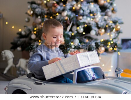 Toy car that transport a Christmas tree on a glowing gold and red background Stock photo © alphaspirit