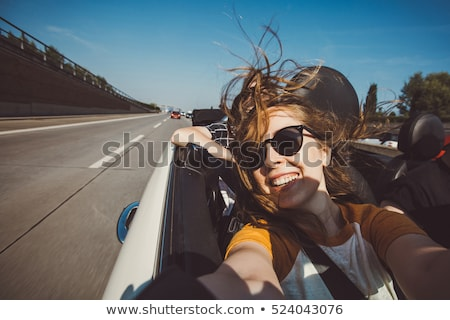 Cheerful couple on a journey - convertible ride Stock photo © konradbak