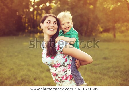 child laughing over mother's shoulder Stock photo © IS2