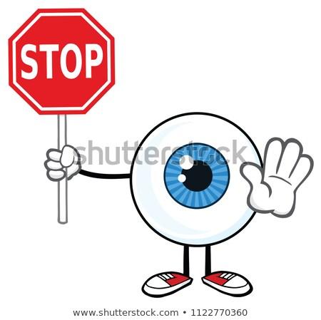 eyeball cartoon mascot character holding a stop sign stock photo © hittoon