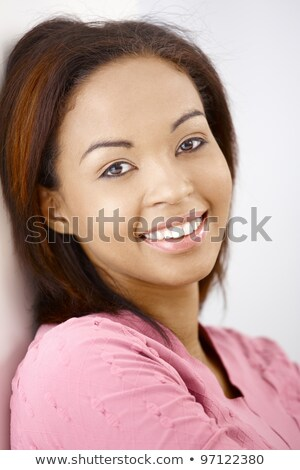 Closeup photo of young afro american woman 20s wearing casual t- Stock photo © deandrobot