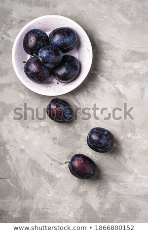 bowl of wet ripe plums stock photo © dash