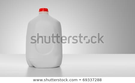 Stock photo: Fresh dairy products on white table background. Plastic bottle and glass of milk, bowl of cottage ch