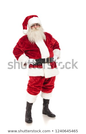 funny santa claus holds hips and leans back while standing Stock photo © feedough