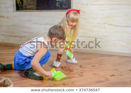 Two kids sweeping the floor Stock photo © colematt
