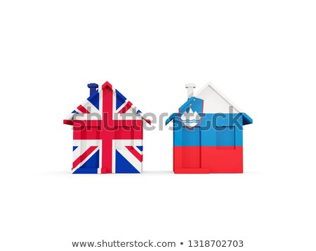 Two houses with flags of United Kingdom and slovenia Stock photo © MikhailMishchenko