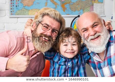 Zachwycony syn ojca wraz zielone parku Zdjęcia stock © deandrobot