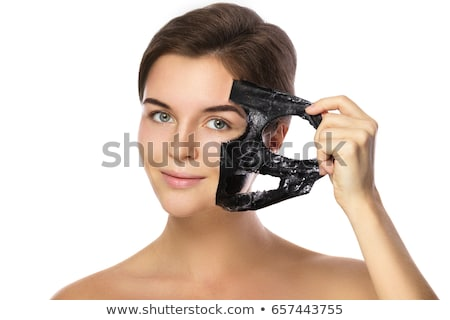 Woman Removing Peeling Mask From Her Face Stock photo © AndreyPopov