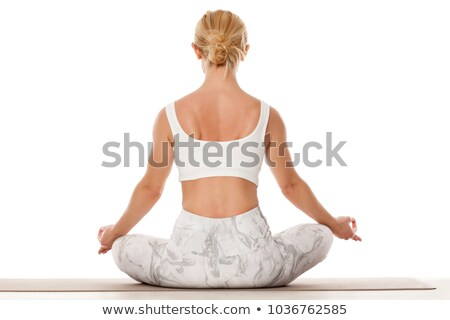 Attractive young blonde woman exercising and sitting in yoga lotus position Stock photo © dash