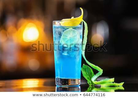 Blue lagoon cocktail  with ice and orange Stock photo © furmanphoto