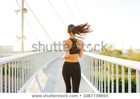 arkadan · görünüm · şaşırtıcı · spor · kadın · egzersiz · halter - stok fotoğraf © deandrobot
