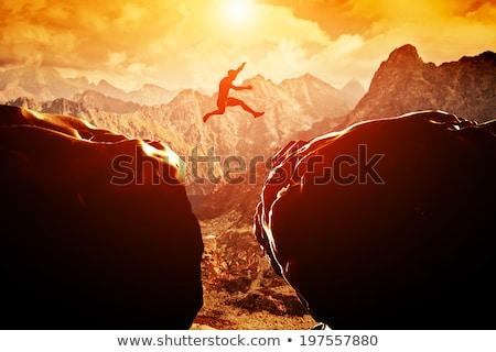 Man springen bergen gelukkig zomer natuur Stockfoto © AndreyPopov