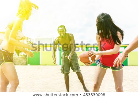 Teenage Boy With Rugby Ball On Beach Stock photo © monkey_business
