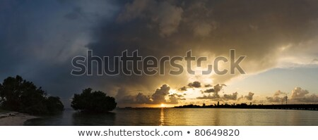 Puesta de sol nubes de tormenta rojo montanas lejos distancia Foto stock © lovleah