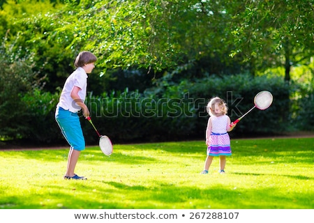 Two girls in play school having fun with a ball Stock photo © Kzenon