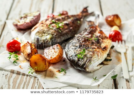 Fried sea bream with fresh thyme Stock photo © Alex9500