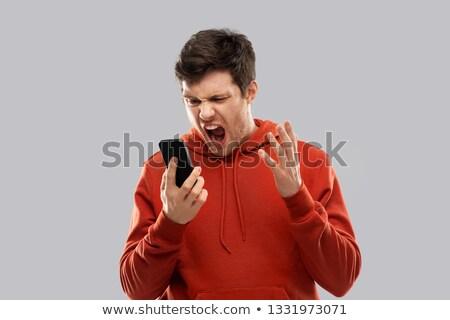 Deli adam kırmızı çığlık atan negatif Stok fotoğraf © dolgachov
