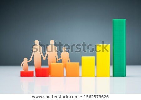 Family Cutout Paper Behind Chart On Desk Stock photo © AndreyPopov