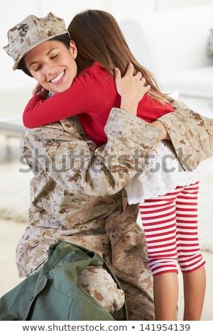 Katona búcsú ölel lánygyermek gyerekek férfi Stock fotó © HighwayStarz