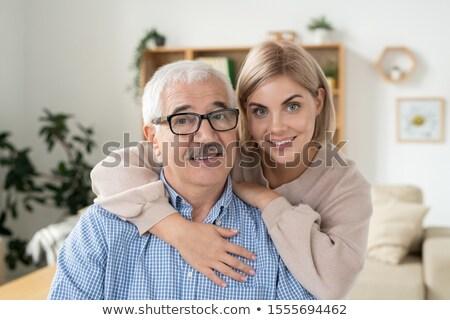 Fiatal mosolyog szőke nő átkarol kopott nyugdíjas Stock fotó © pressmaster