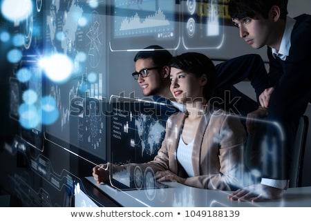 Man gegevens hologram kantoor panoramisch Windows Stockfoto © ConceptCafe