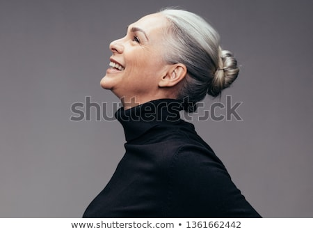 Smiling black hair woman on grey background Stock photo © Lopolo