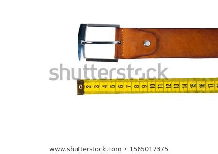 Measuring width of leather belt Stock photo © pressmaster