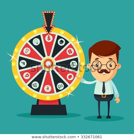Man Standing near Fortune Wheel, Winner of Game Stock photo © robuart