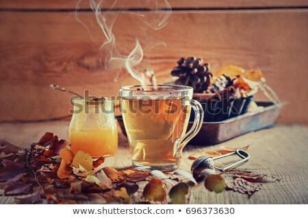 Tasse schwarz Tee Herbst Ahorn Blätter Stock foto © dolgachov