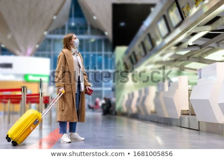 COVID-19 Corona virus airport travel restrictions with face mask, passport, plane ticket, suitcase a Stock photo © Maridav