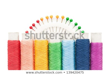 bobbins of multicolor thread over white background stock photo © tetkoren