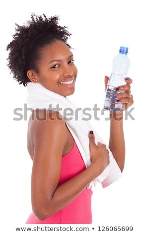 Mooie vrouw fles water witte vrouw sexy Stockfoto © dacasdo