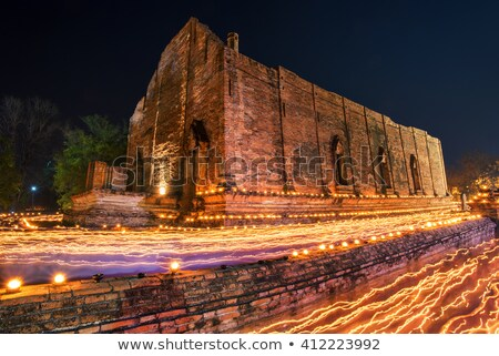 candle light trail of Buddhism Ceremony at temple ruin on Asalha Stock photo © vichie81