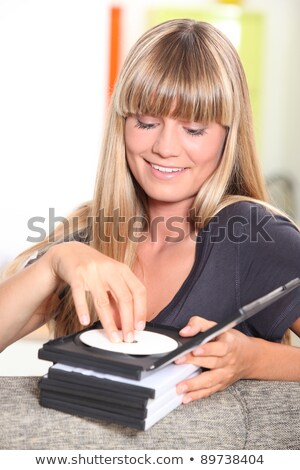 fair-haired damsel with CDs Stock photo © photography33