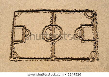 A soccer pitch drawn on a sandy beach. Stock photo © latent