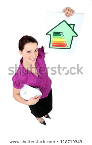 Female architect holding energy rating card Stock photo © photography33