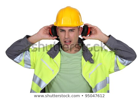 builder with hard hat removing earmuffs Stock photo © photography33