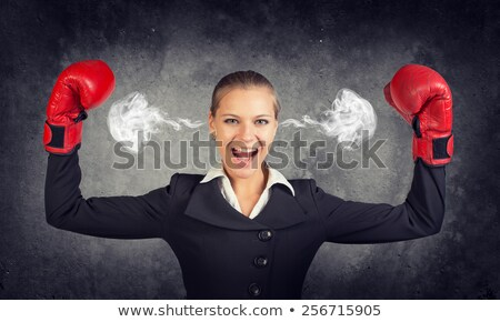 Businesswoman earing boxing gloves Stock photo © photography33