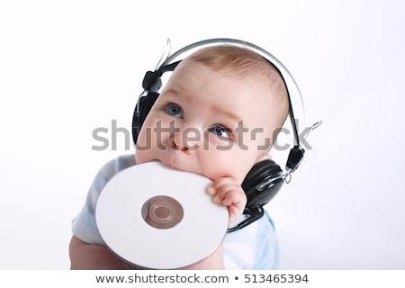 Jonge kind spelen cd computer geïsoleerd Stockfoto © gewoldi