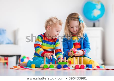 Little girl preschooler playing with toy railway Stock photo © pzaxe