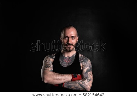 Guy in bandage on a black background Stock photo © pzaxe