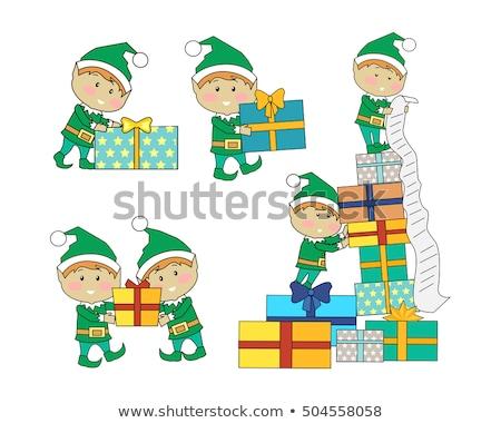 happy santa helper with green cube stock photo © dolgachov