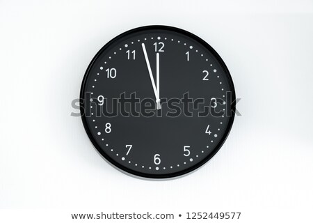 Black wall clock, five minutes to twelve  Stock photo © inxti