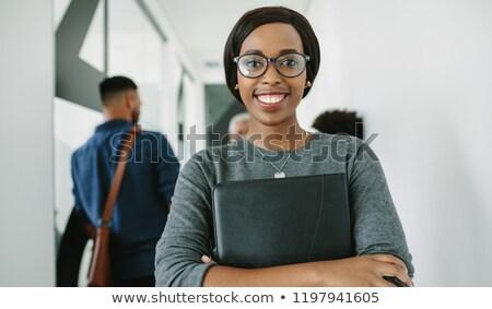 Jovem empresário óculos dobrador Foto stock © photography33